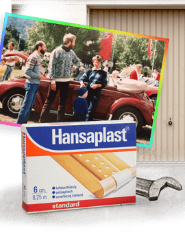 1989: Three young men in front of VW beetle, historic Hansaplast plaster package, garage door.