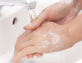 Close up of washing hands under running water