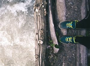 Sport shoes standing at the edge of a river