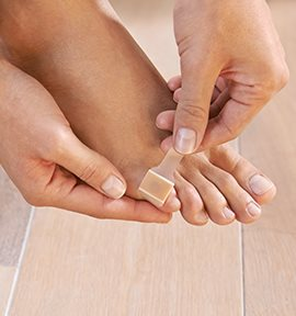 Plaster being applied to pinky toe