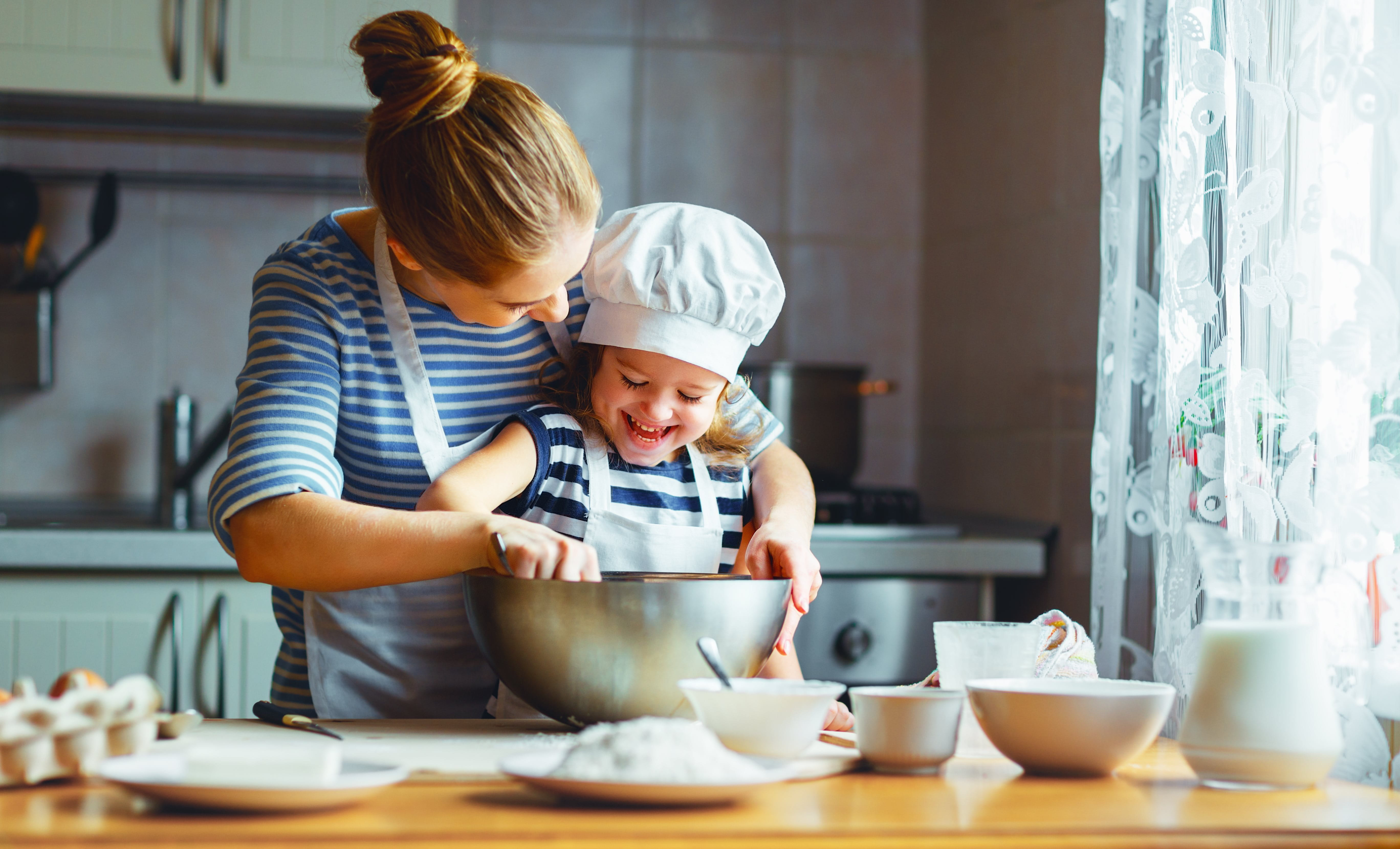 Woman and child baking in kitchen