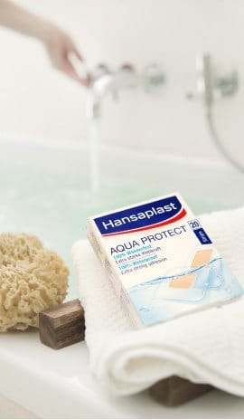 Aqua Protect Plasters in front of a bath tub